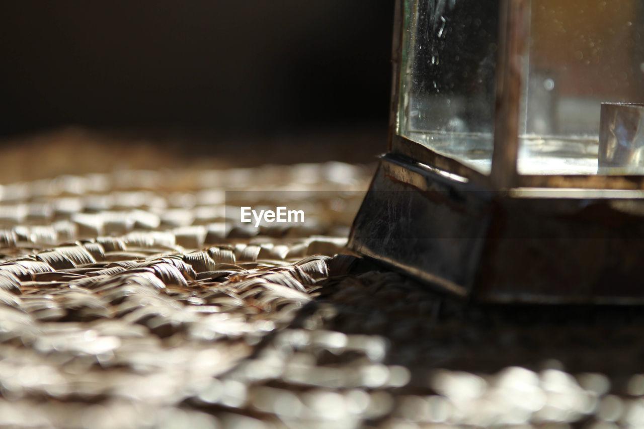 Close-up of lantern on rug