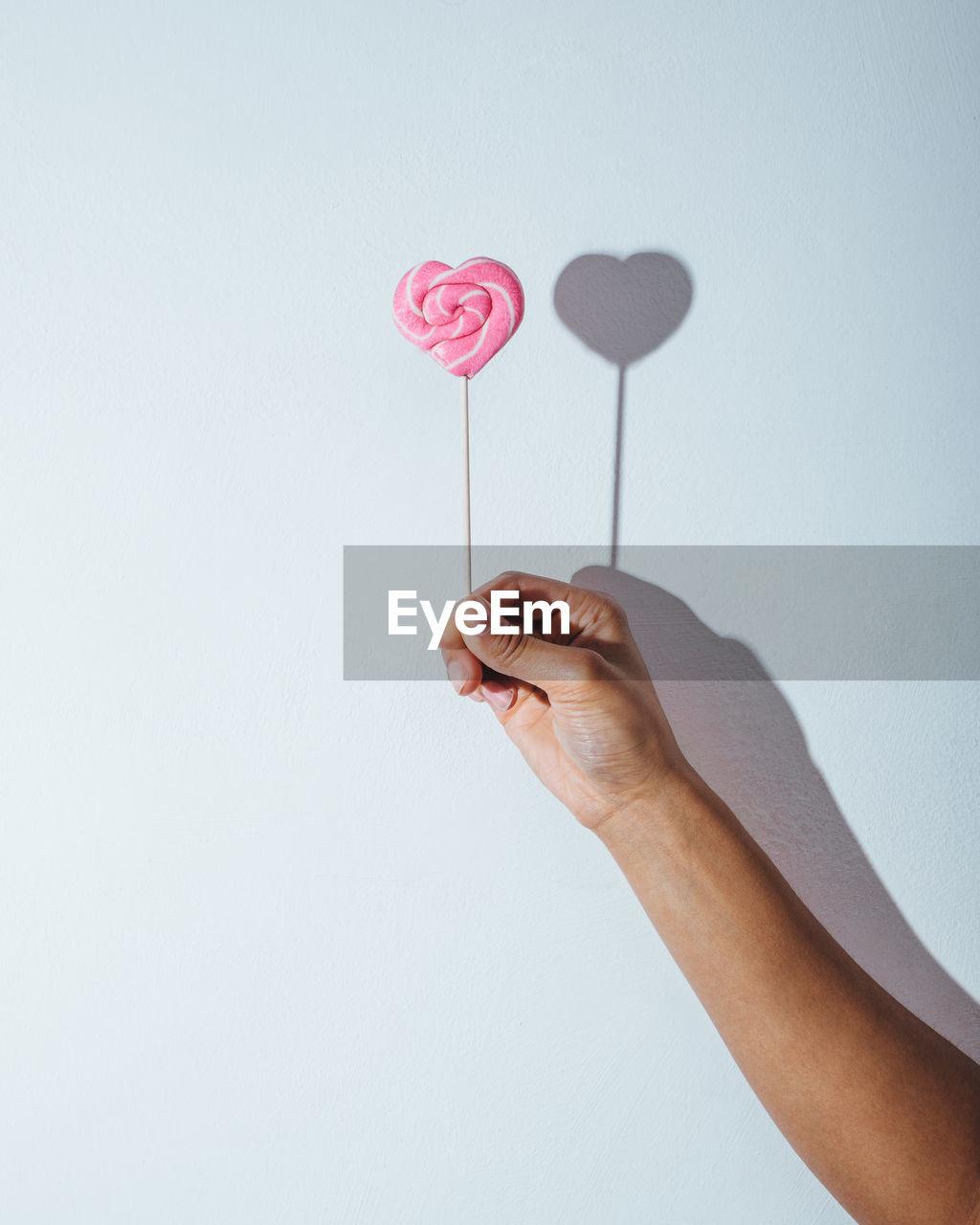 Woman hand holding lollipop