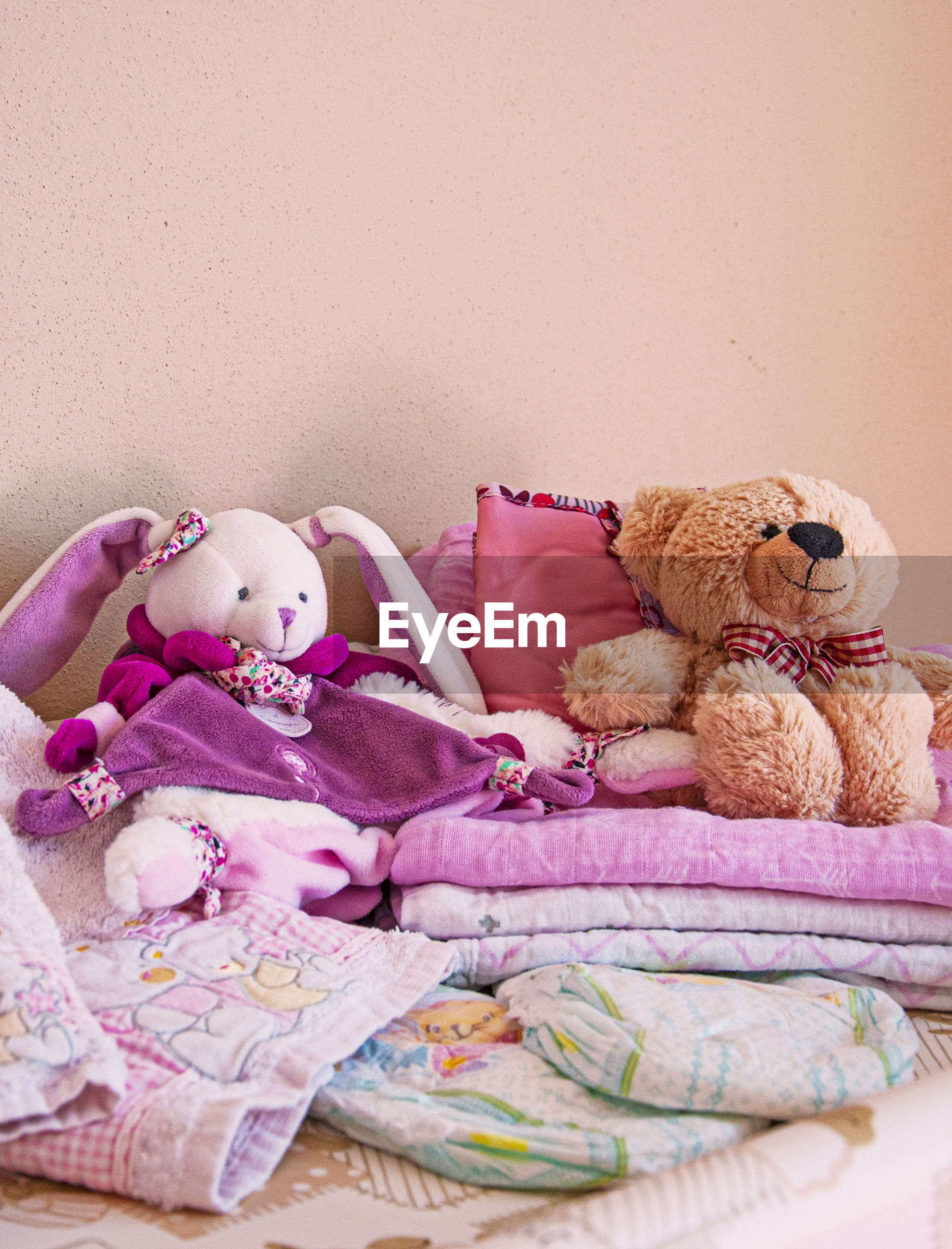 STUFFED TOY ON BED