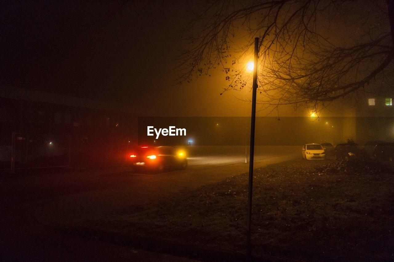 illuminated, night, transportation, car, land vehicle, lighting equipment, mode of transport, street light, no people, road, street, outdoors, sky, nature