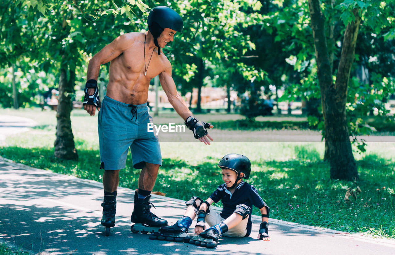 men, tree, males, child, real people, childhood, full length, togetherness, leisure activity, family, day, plant, mid adult, casual clothing, father, parent, lifestyles, mid adult men, boys, nature, son, outdoors, positive emotion