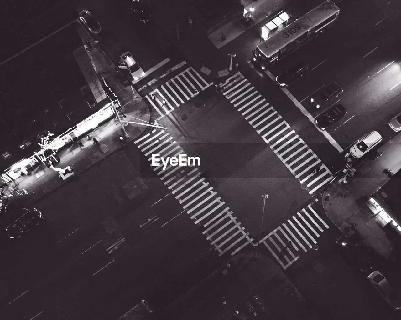 High angle view of crosswalk on city road at night