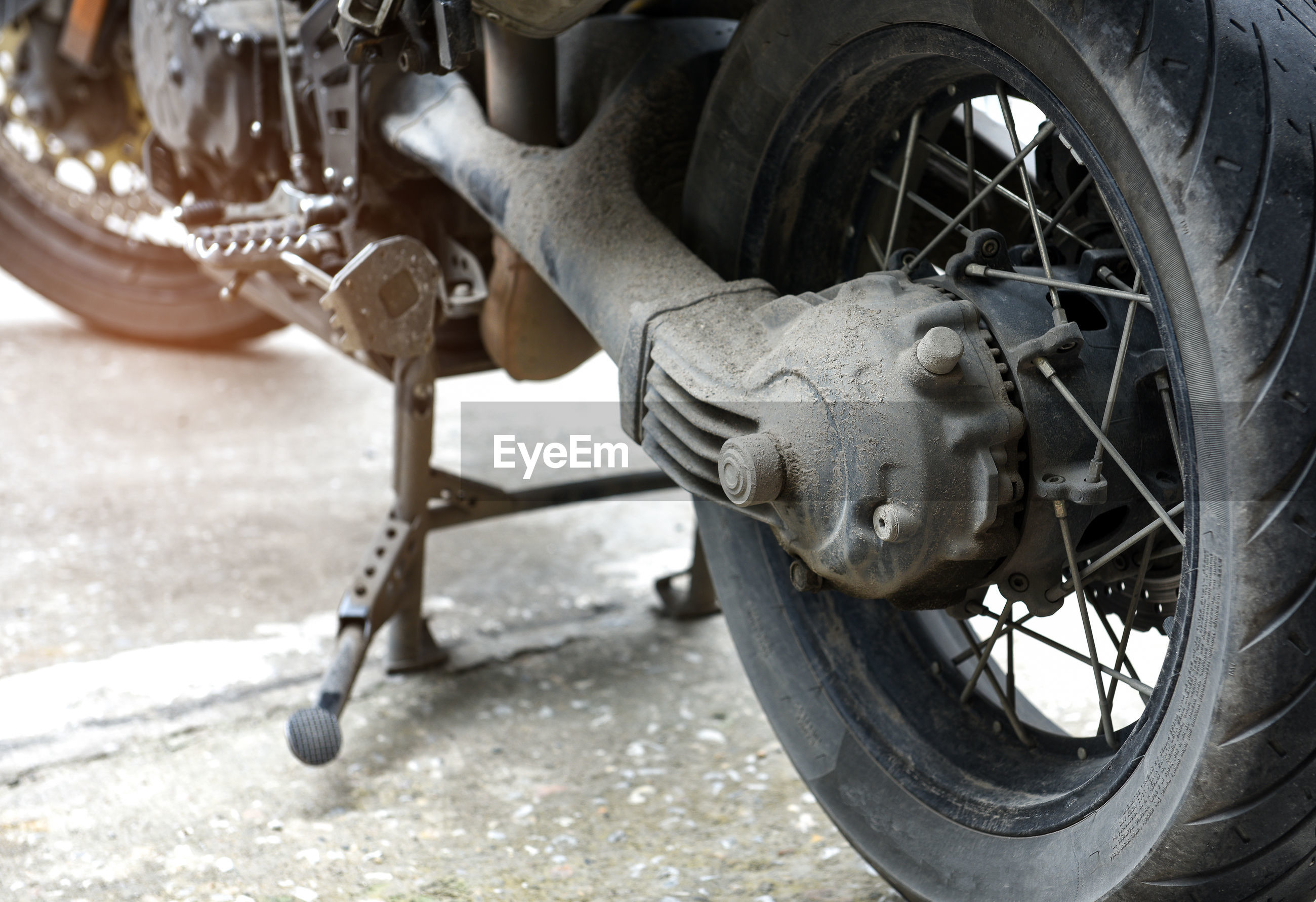 Close-up of motorcycle on road