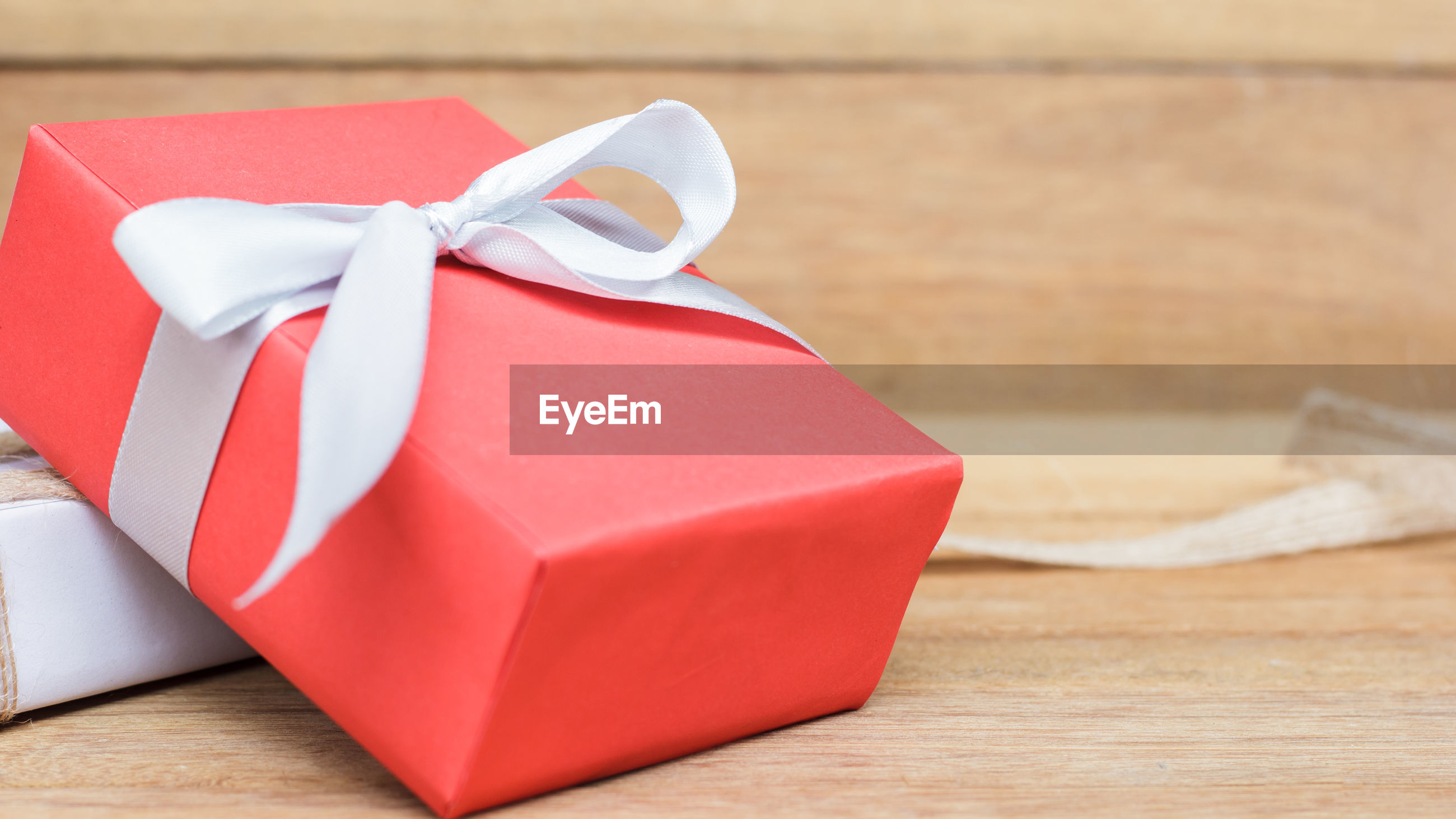 Close-up of red wrapped gift on table