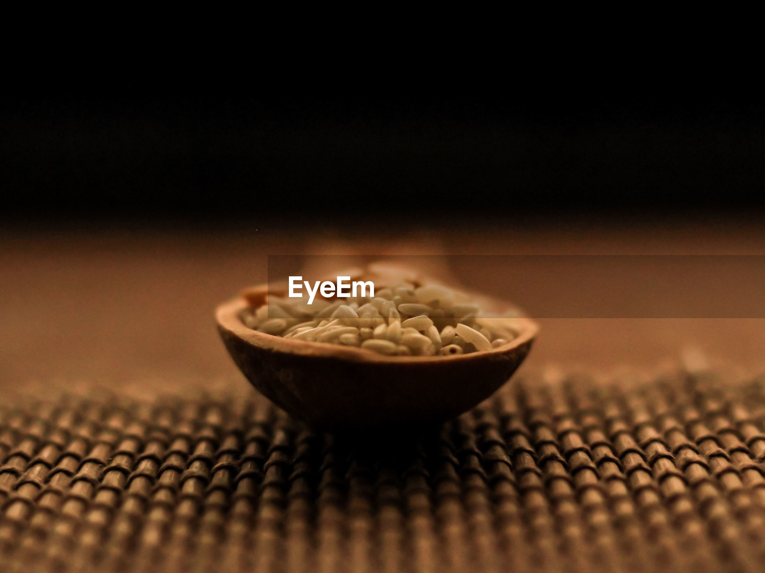 Close-up of rice in spoon on table