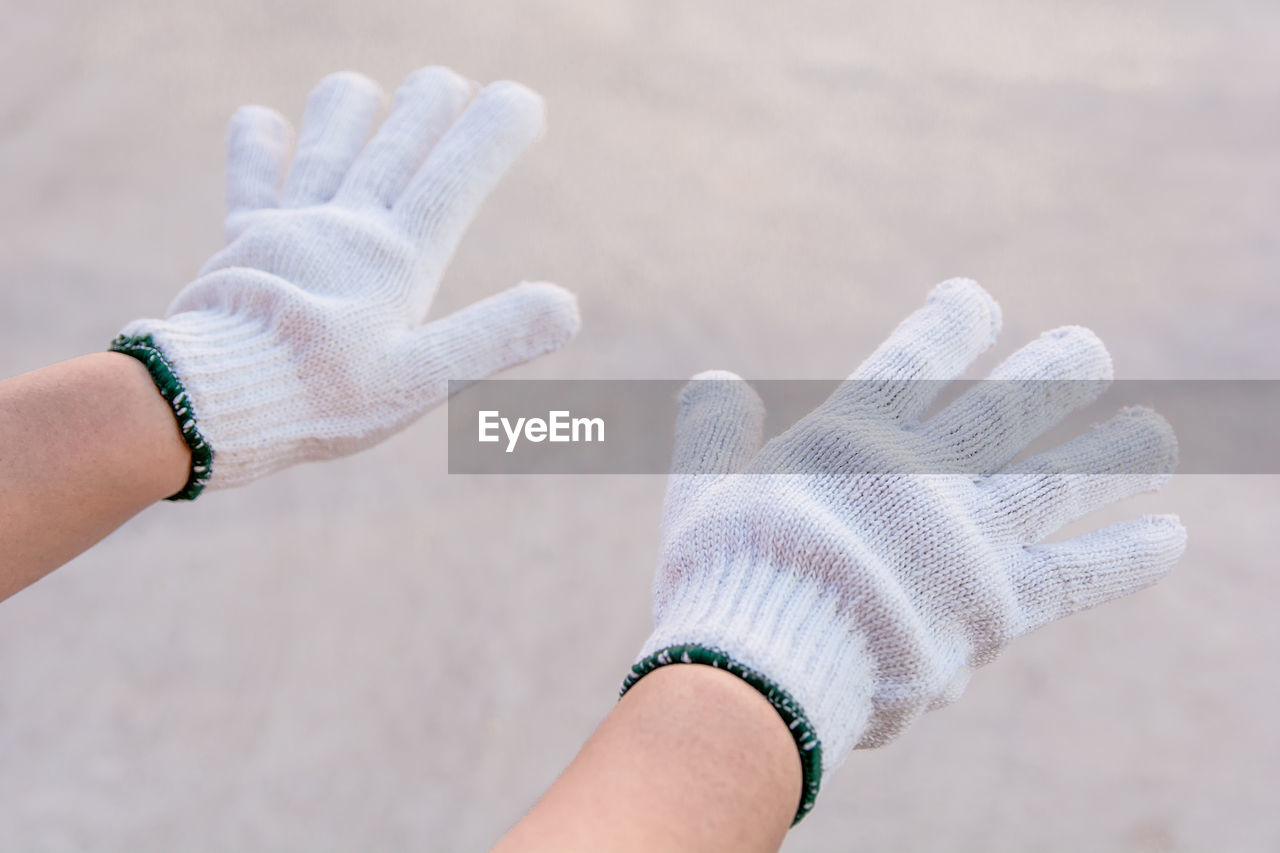 Cropped hands of person wearing gloves