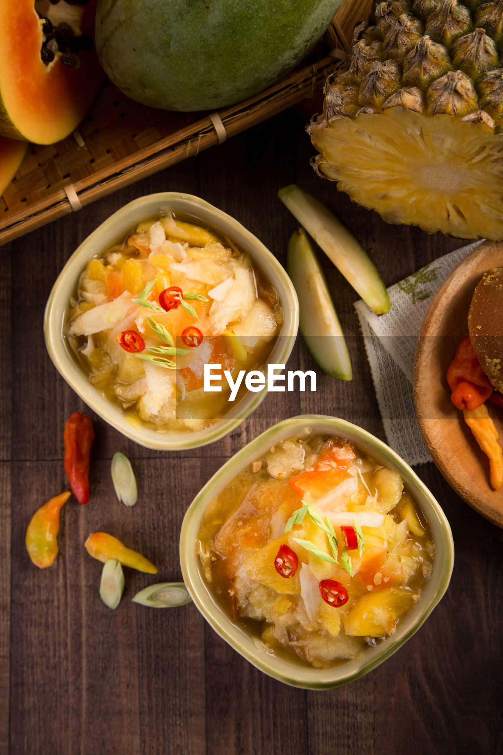 Directly above shot of food in bowls on wooden table