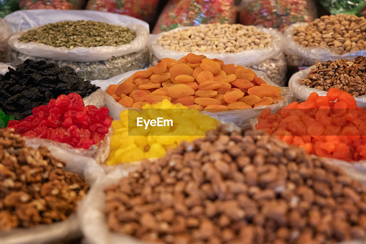 variation, choice, food, food and drink, freshness, market, for sale, selective focus, still life, dried fruit, dried food, multi colored, healthy eating, large group of objects, market stall, no people, wellbeing, abundance, retail, arrangement, retail display, raisin, order