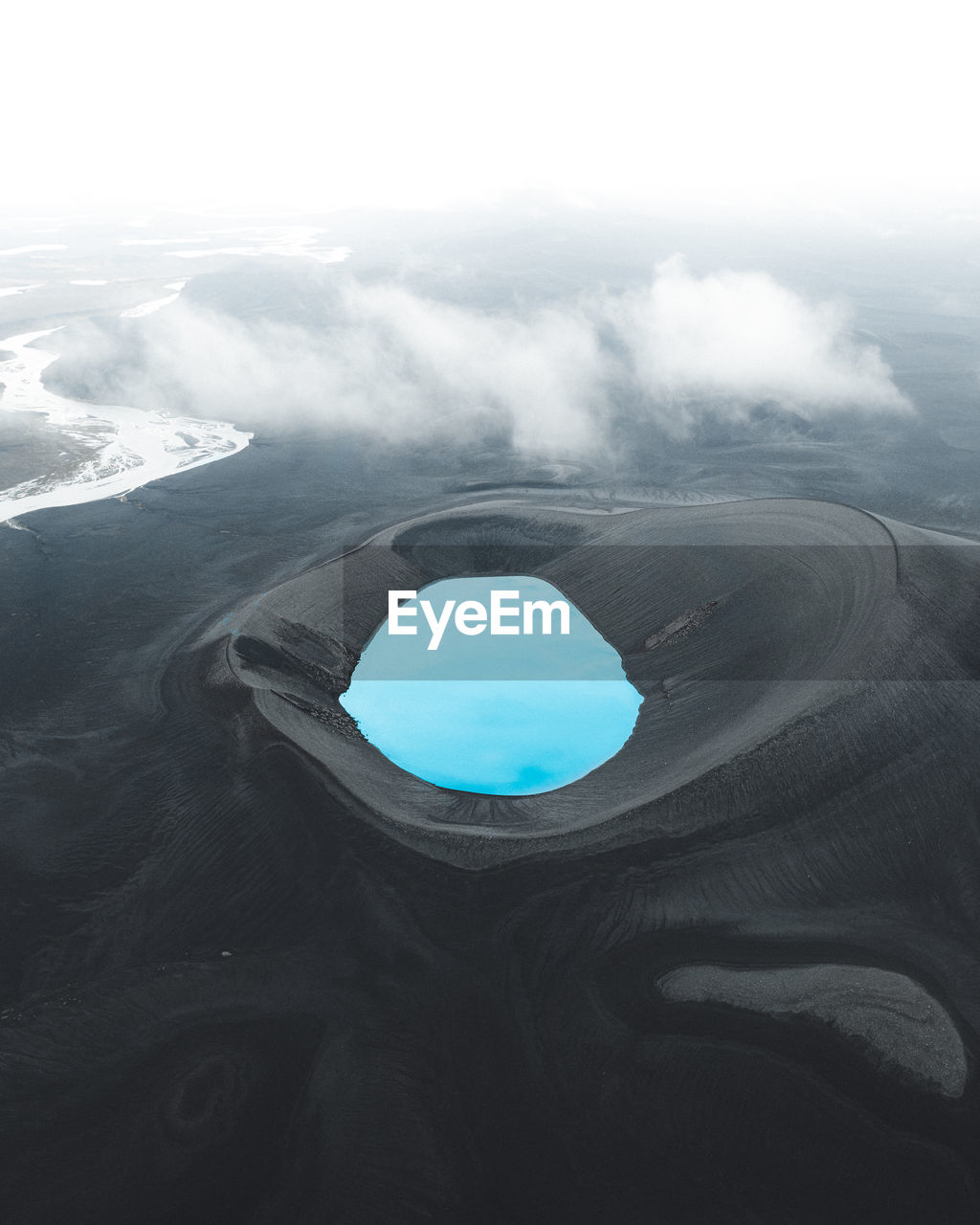 Aerial view of lake amidst mountain