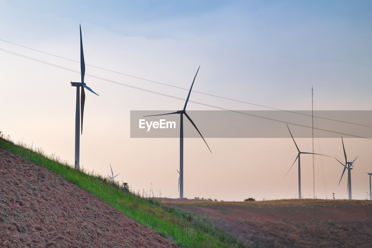 alternative energy, wind power, wind turbine, fuel and power generation, environmental conservation, renewable energy, field, windmill, rural scene, industrial windmill, nature, no people, landscape, sky, outdoors, sunset, day, agriculture, technology, electricity, grass, beauty in nature