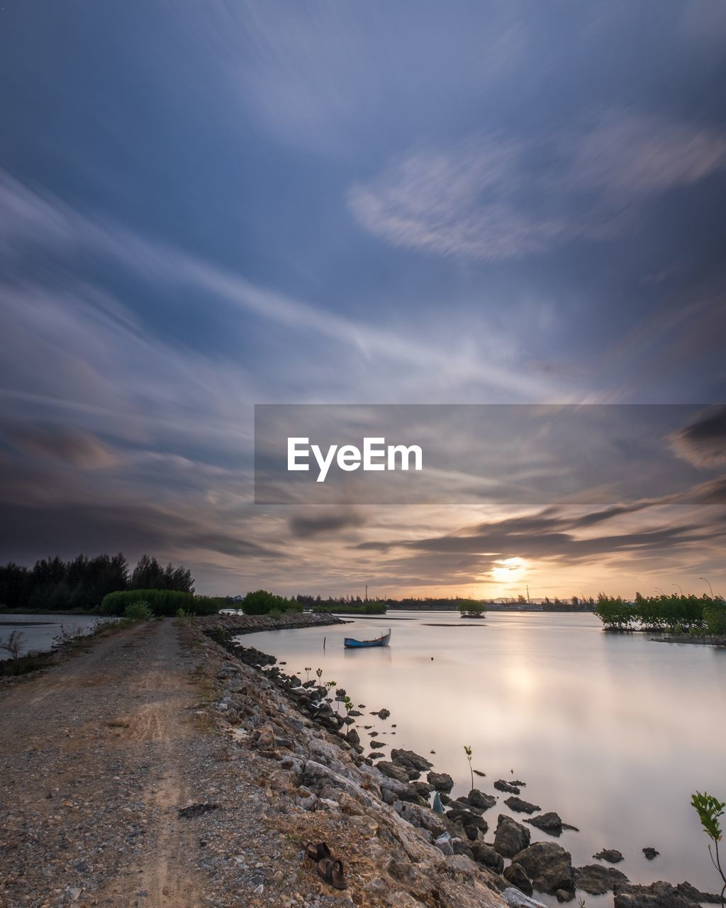 sky, water, cloud - sky, scenics - nature, nature, beauty in nature, tranquility, tranquil scene, no people, sunset, reflection, outdoors, non-urban scene, sea, architecture, built structure, day