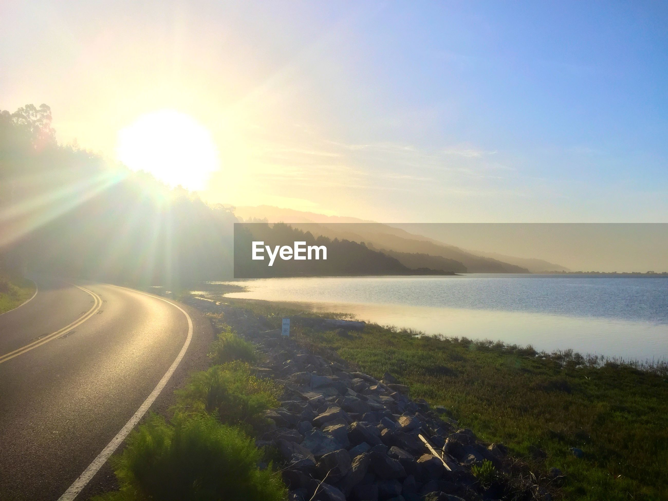 sun, water, sunlight, tranquil scene, sunbeam, tranquility, scenics, sky, road, sea, lens flare, beauty in nature, the way forward, sunset, nature, transportation, reflection, idyllic, landscape, diminishing perspective