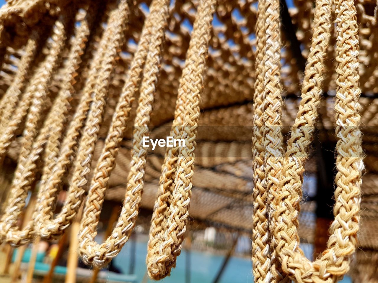 rope, close-up, no people, pattern, strength, backgrounds, focus on foreground, full frame, string, braided, textile, textured, day, repetition, brown, wood - material, selective focus, indoors, connection
