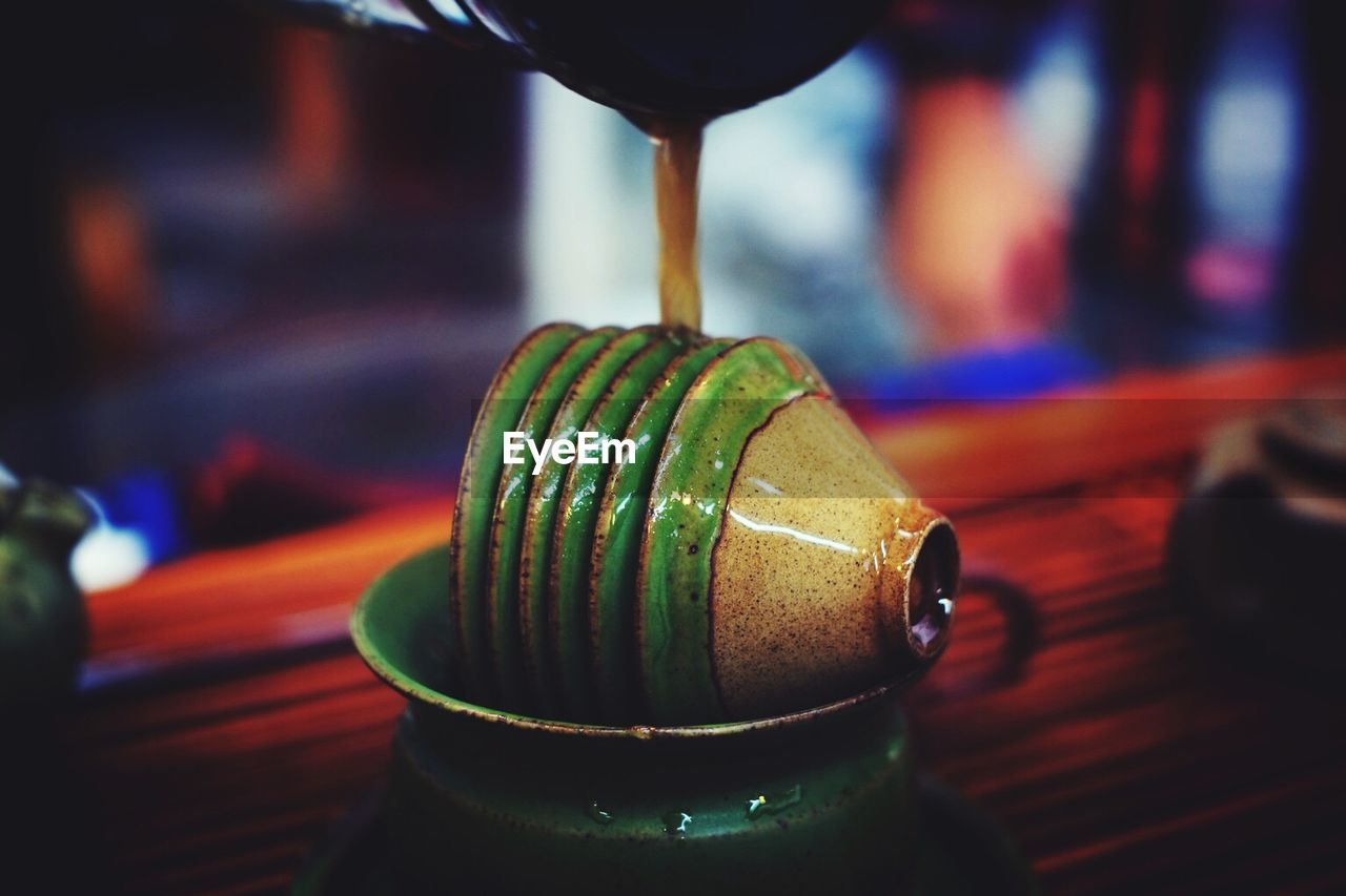 focus on foreground, indoors, close-up, no people, green color, drink, day