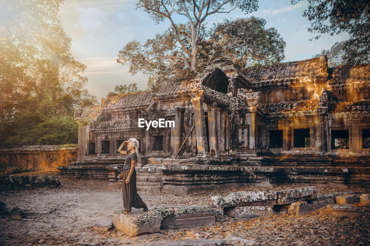 old ruin, ancient, history, built structure, tourism, statue, architecture, travel destinations, damaged, ancient civilization, travel, archaeology, human representation, place of worship, religion, spirituality, bad condition, sky, sculpture, run-down, tree, day, outdoors, building exterior, no people, nature