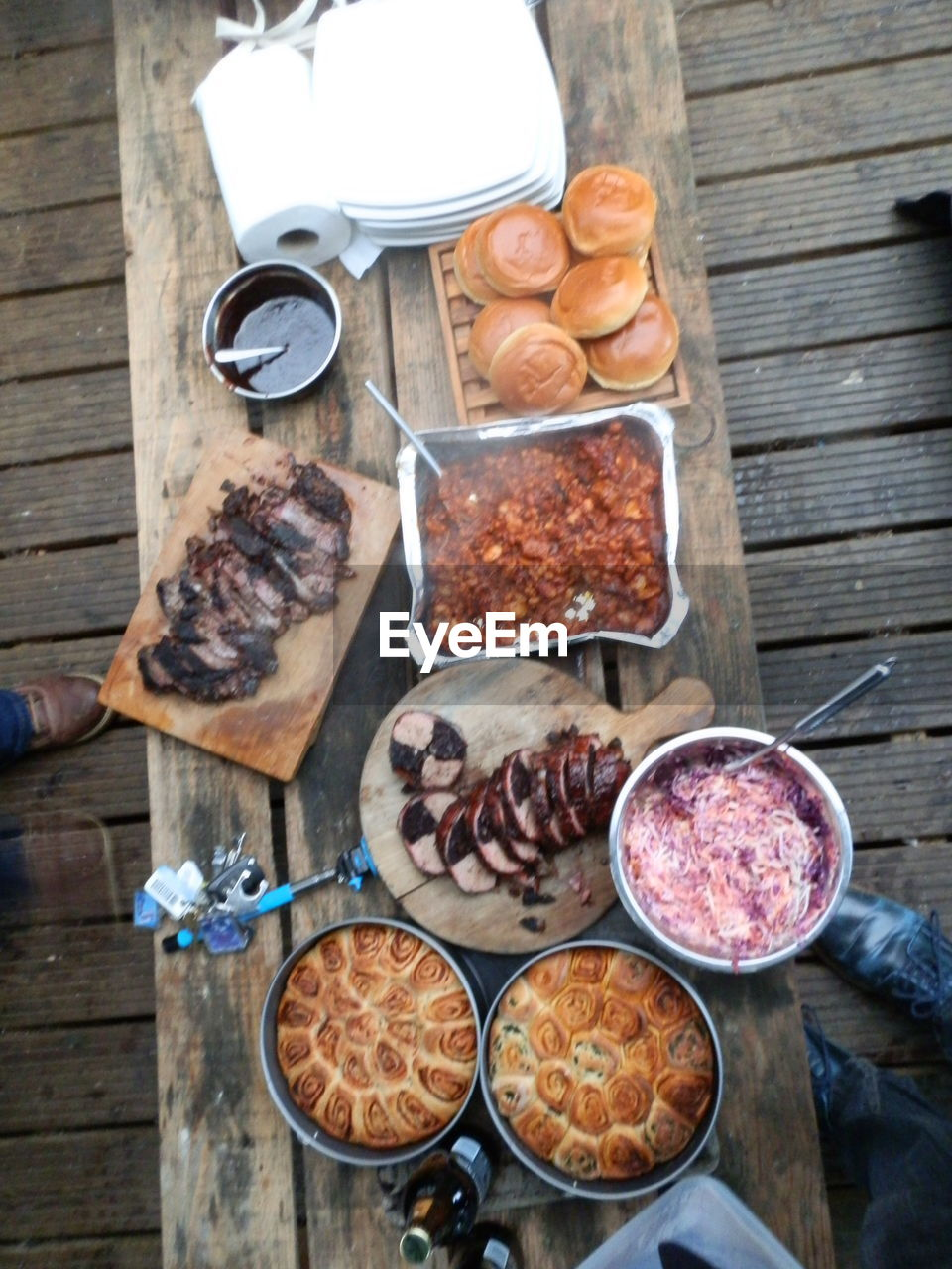 food and drink, food, freshness, drink, directly above, refreshment, table, high angle view, healthy eating, wood - material, choice, meat, kitchen utensil, wellbeing, variation, meal, bowl, plate, no people, spoon, glass, outdoors