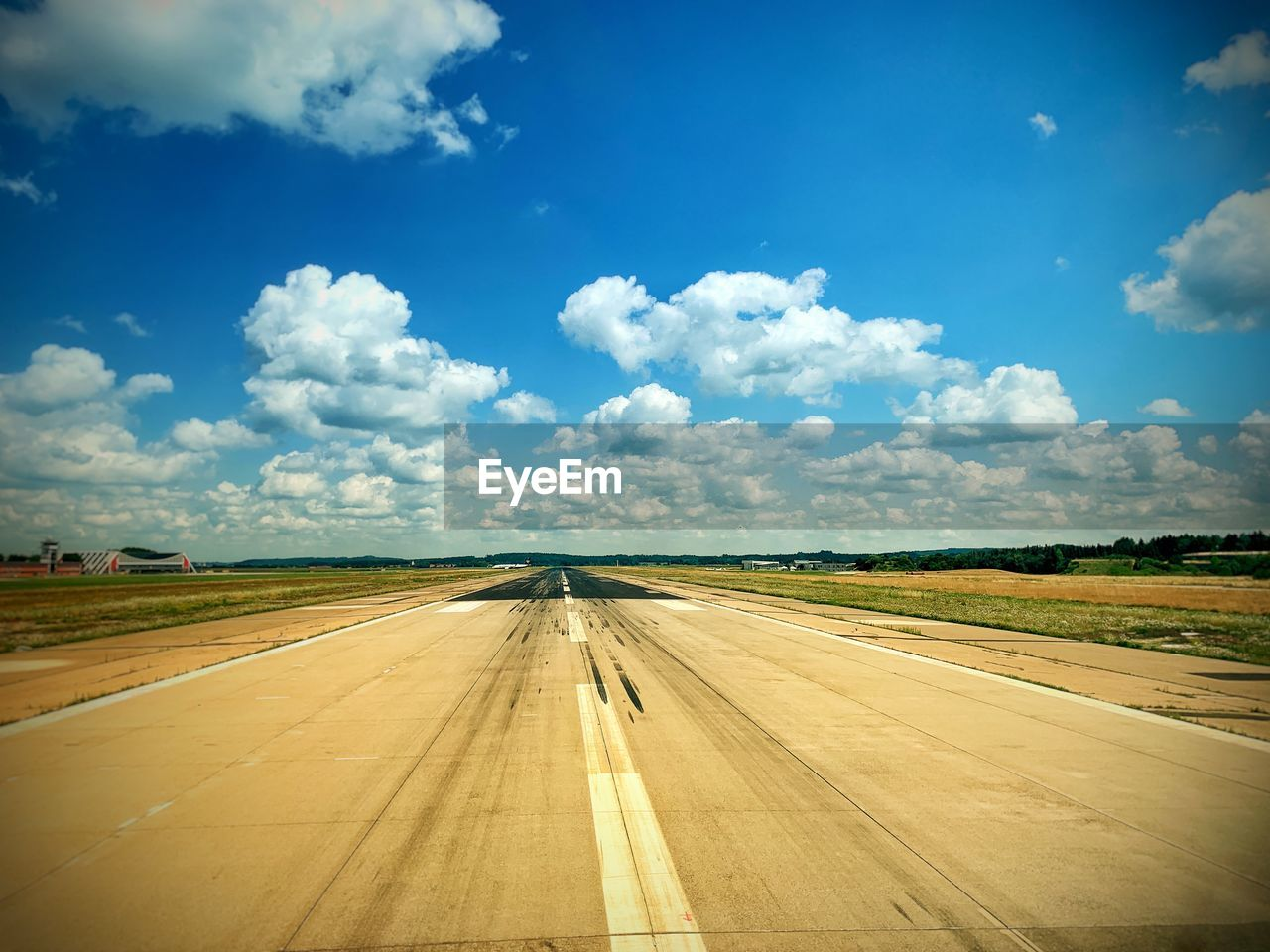 cloud - sky, sky, road, transportation, nature, symbol, day, landscape, direction, no people, environment, sign, marking, airport, the way forward, road marking, diminishing perspective, scenics - nature, airport runway, outdoors, dividing line