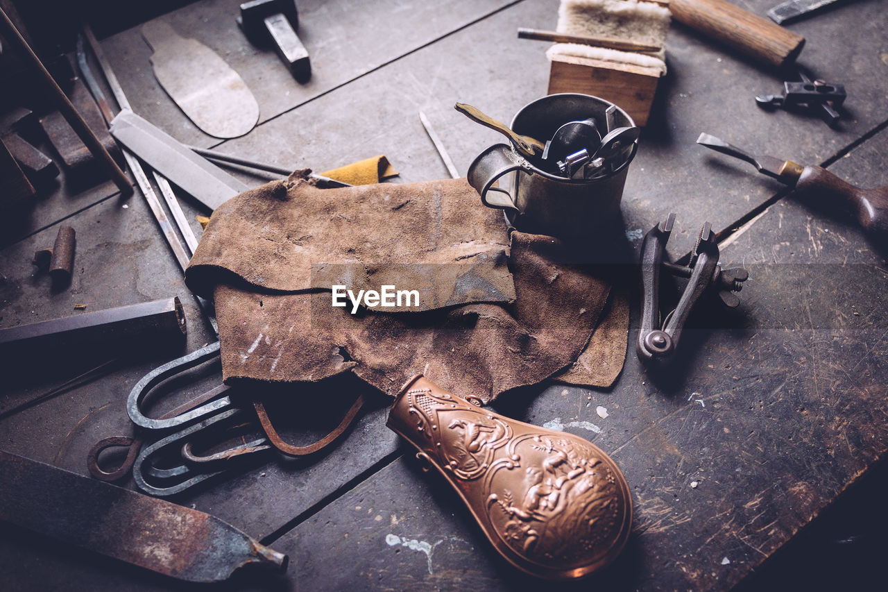 High Angle View Of Old Work Tools On Table