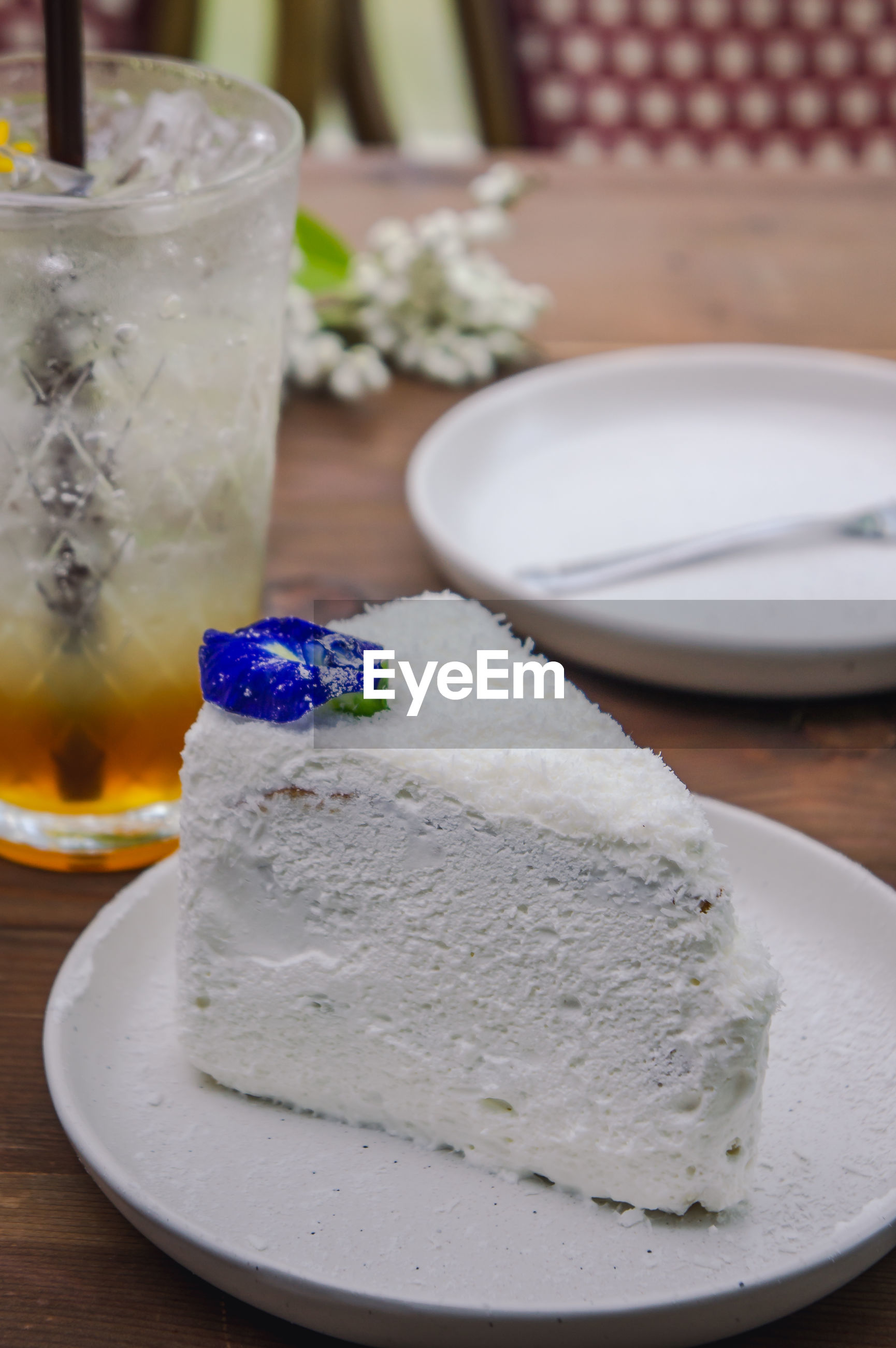 Close-up of cake slice in plate on table
