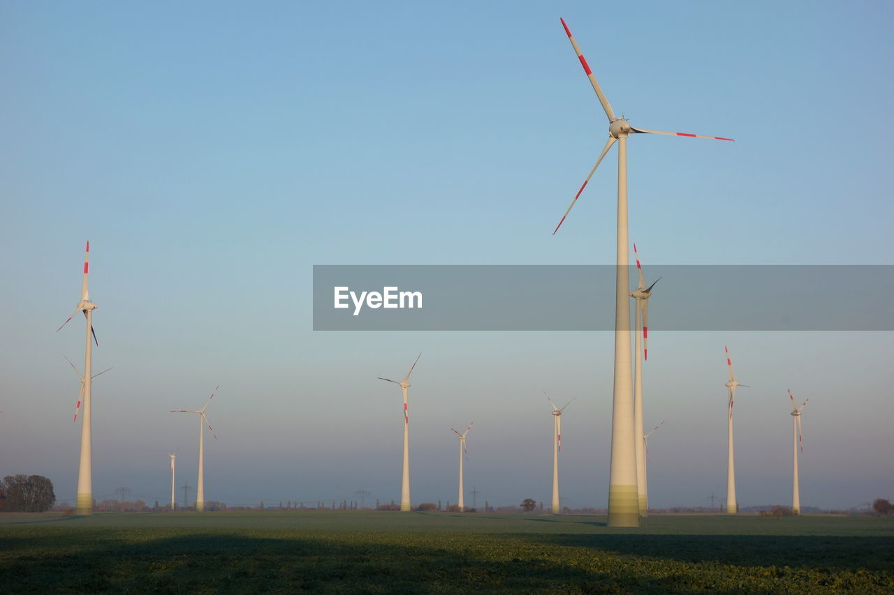 wind turbine, turbine, environmental conservation, renewable energy, environment, alternative energy, fuel and power generation, wind power, sky, field, land, landscape, nature, rural scene, technology, clear sky, day, low angle view, no people, beauty in nature, outdoors, sustainable resources