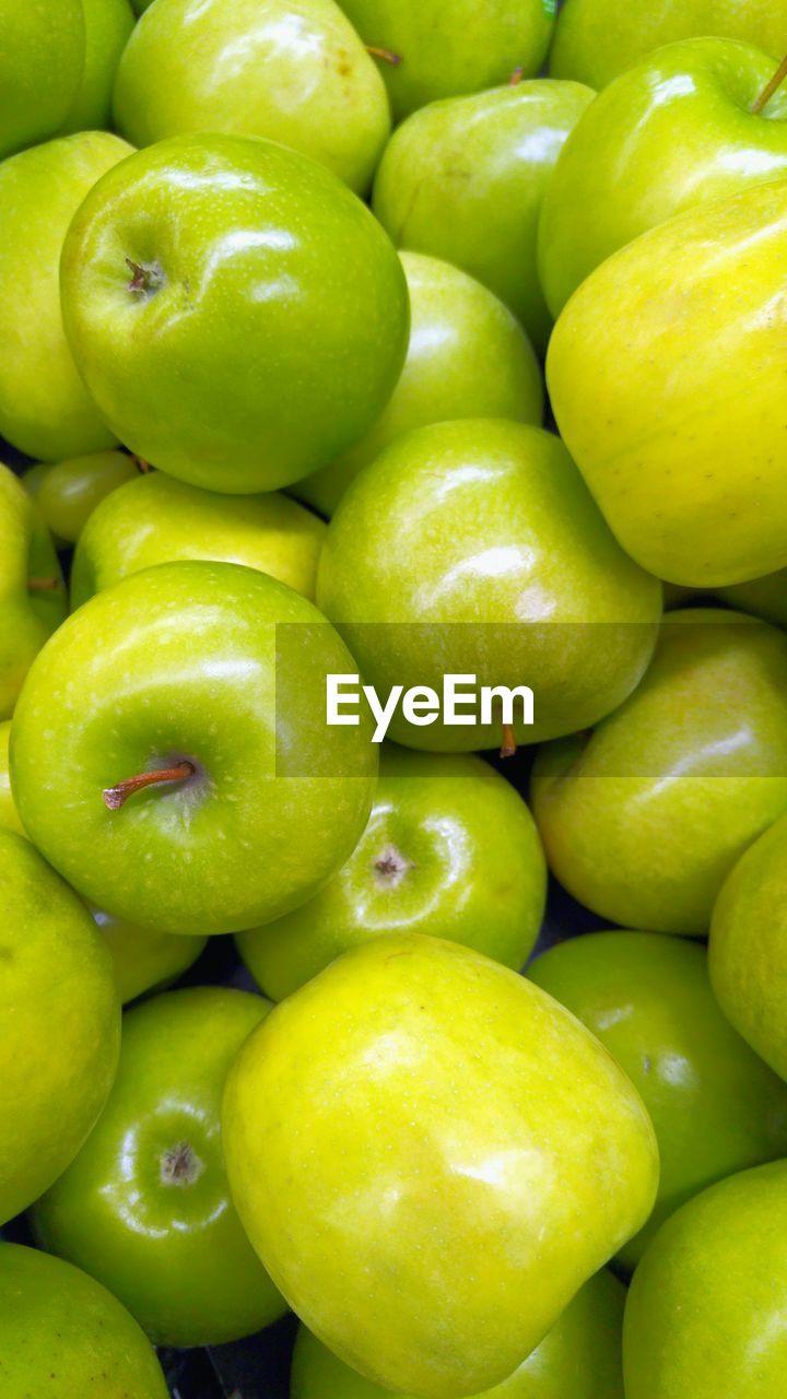 Full Frame Shot Of Granny Smith Apples In Market