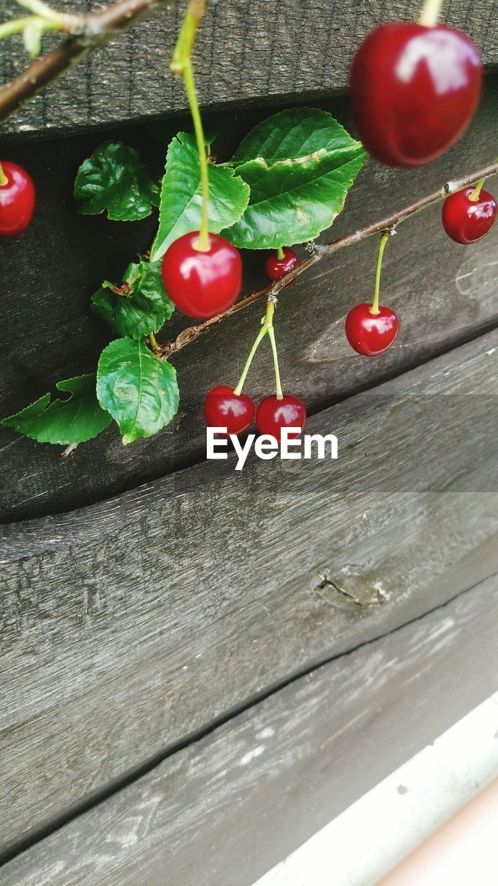 red, food and drink, freshness, food, fruit, cherry, wood - material, no people, table, leaf, indoors, close-up, healthy eating, day, nature