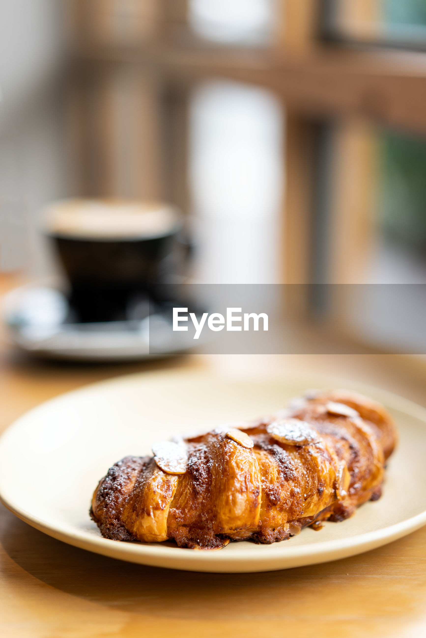 Close-up of croissant served in plate on table