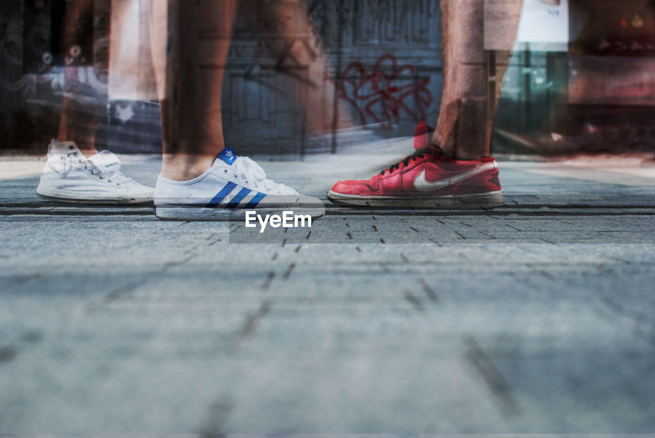 low section, human leg, shoe, human body part, selective focus, day, real people, two people, outdoors, men, close-up, adult, people