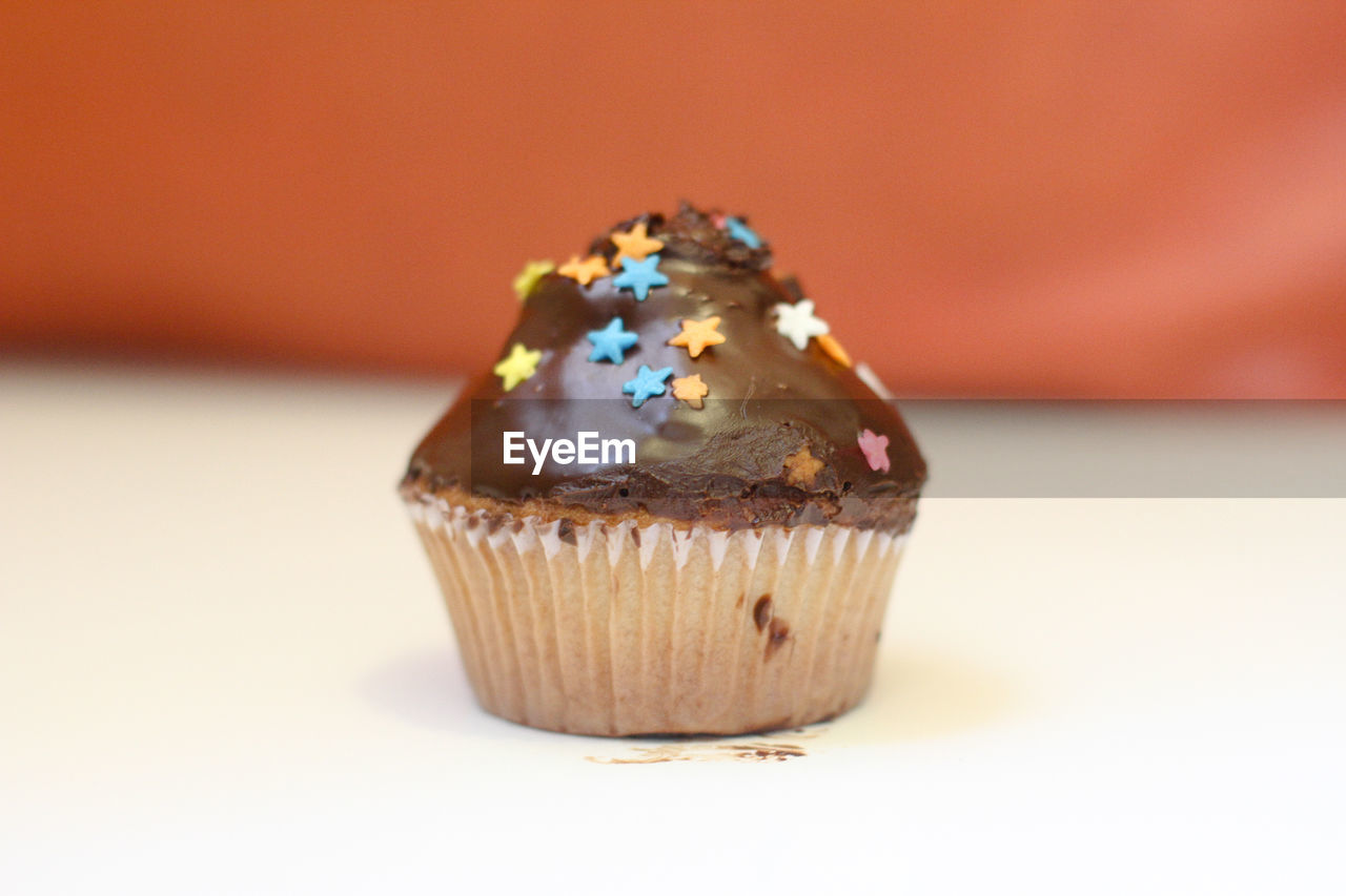 Close-up of cupcake with star shape decoration on table