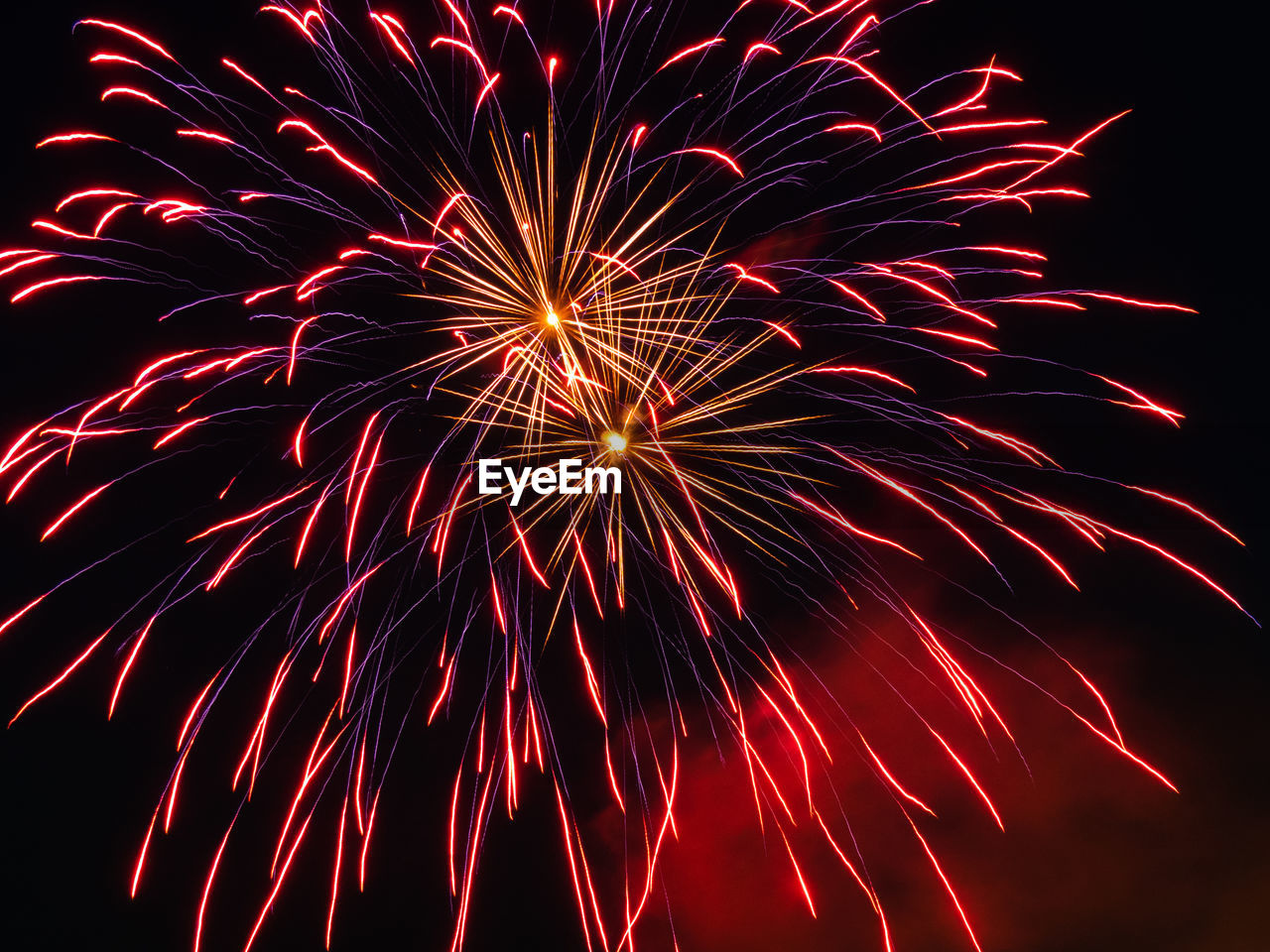 Low angle view of colorful firework display at night
