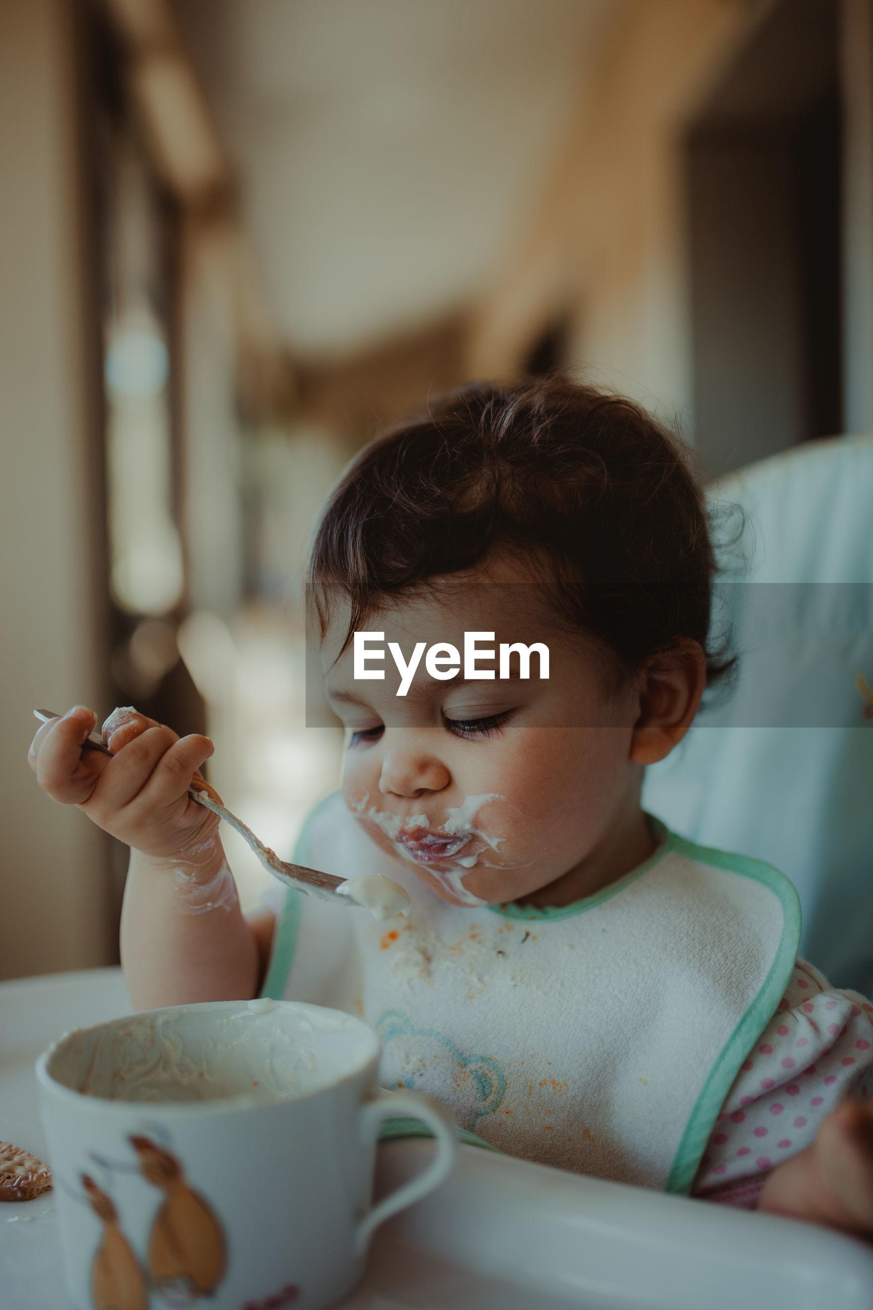 Baby girl having food