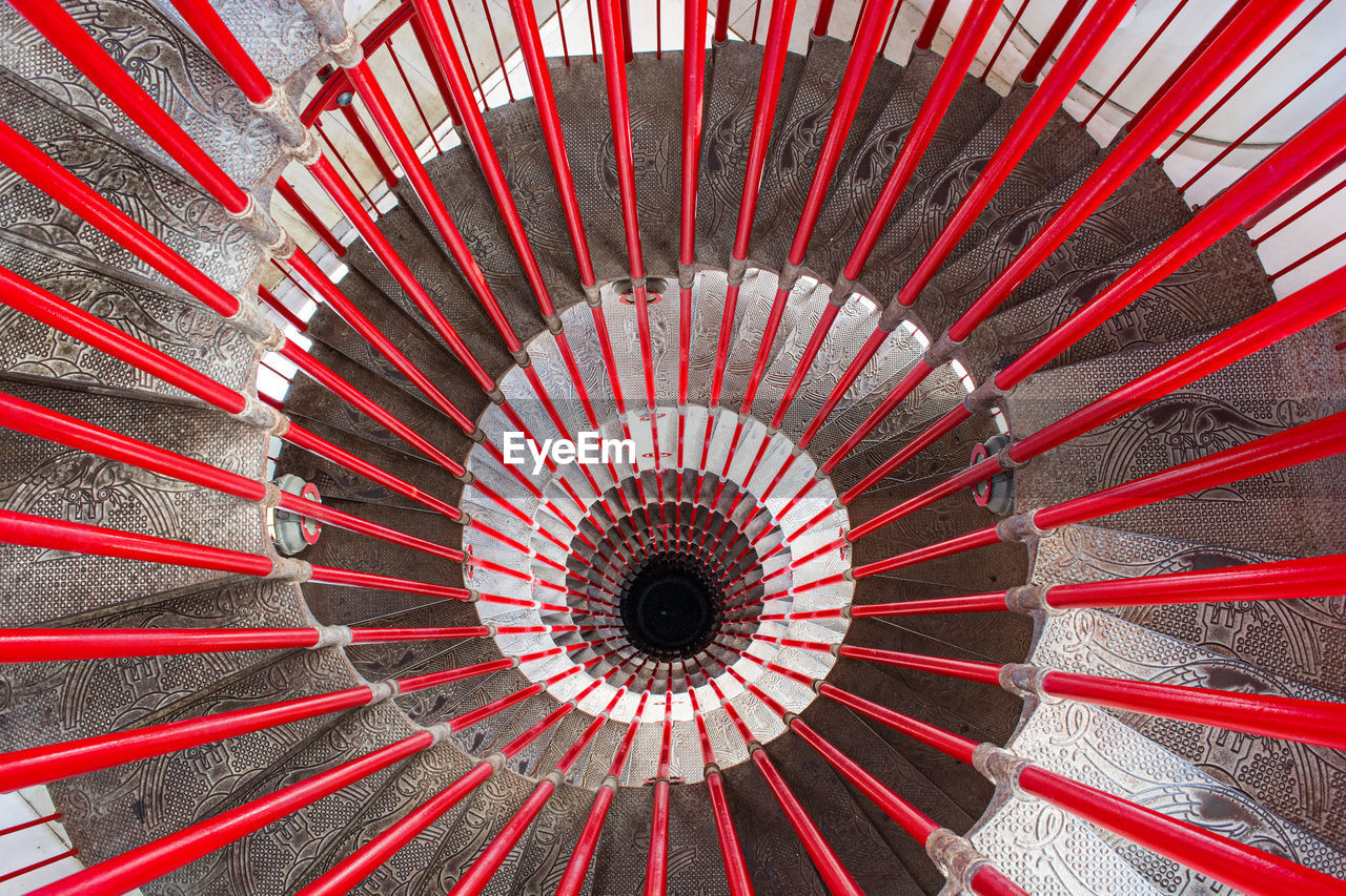 High Angle View Of Red Spiral Staircase