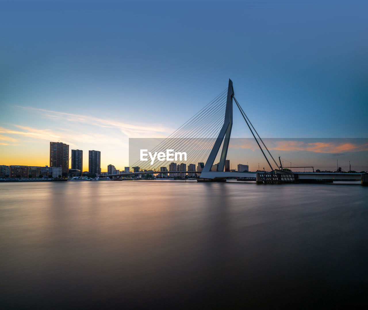 water, sky, architecture, built structure, waterfront, transportation, bridge - man made structure, bridge, connection, no people, city, river, nature, building exterior, reflection, cable-stayed bridge, sunset, outdoors, bay, skyscraper
