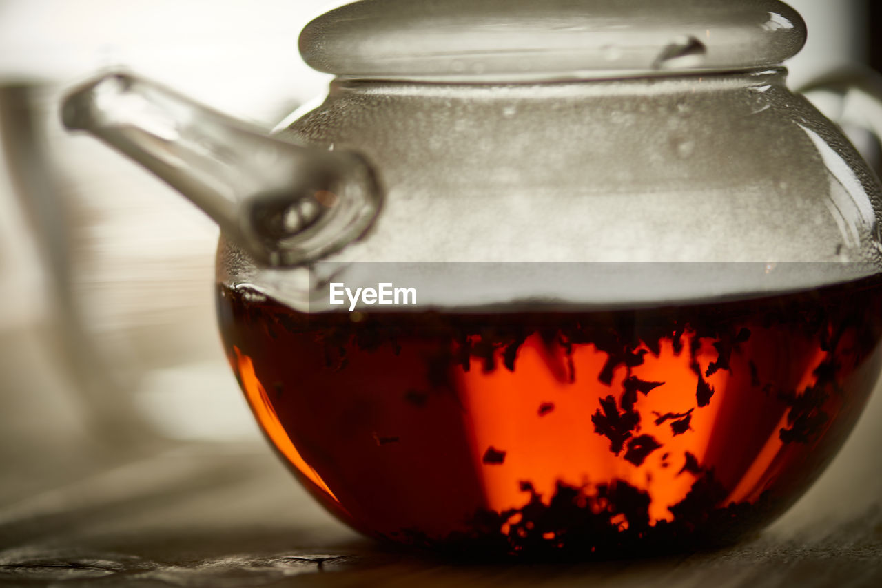 Tea leaves in pot on table