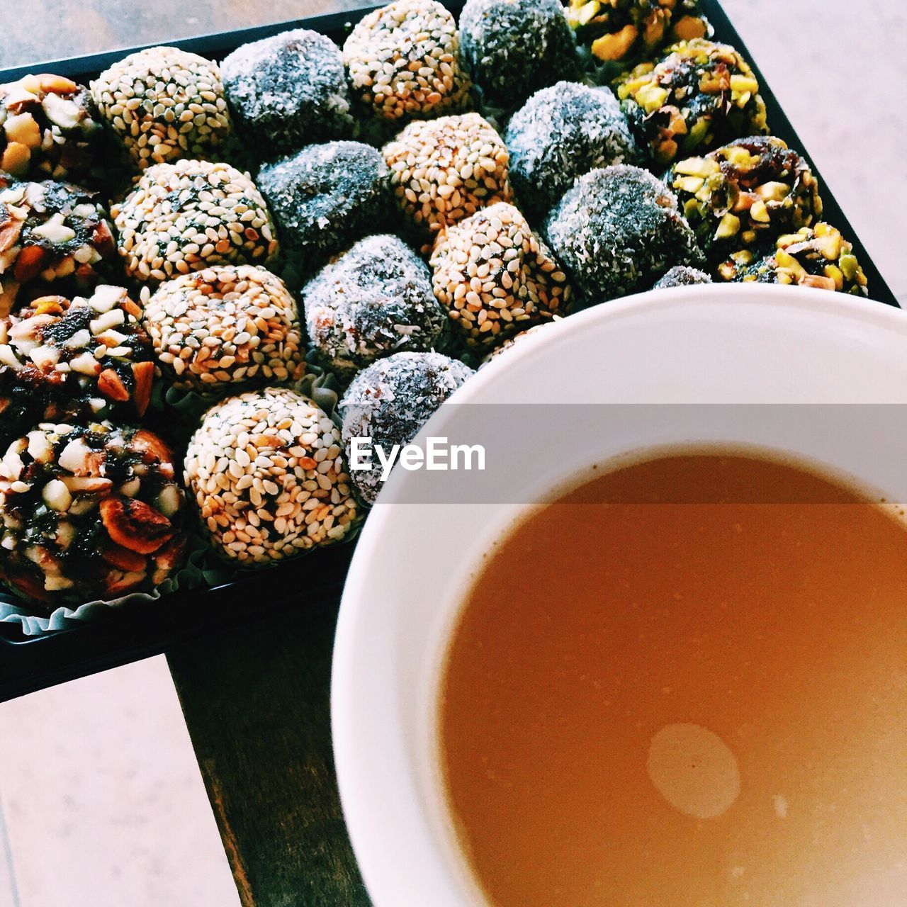 Close-up Of Tea And Cookies On Table