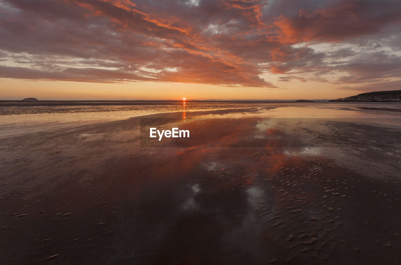 sky, sunset, scenics - nature, water, cloud - sky, beauty in nature, sea, tranquil scene, tranquility, orange color, reflection, idyllic, nature, horizon, horizon over water, beach, no people, non-urban scene, waterfront, outdoors, salt flat