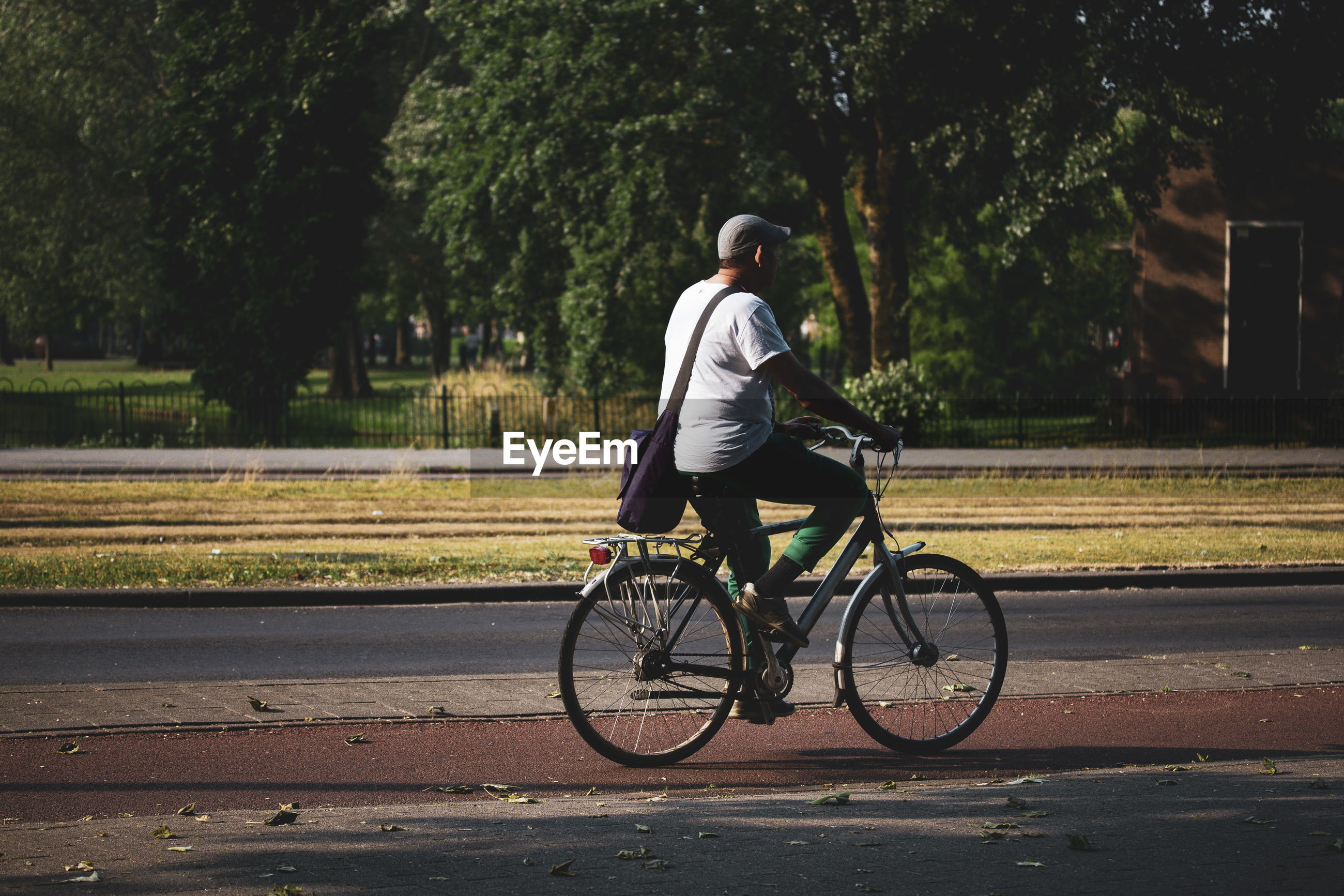 Full length of man cycling on road