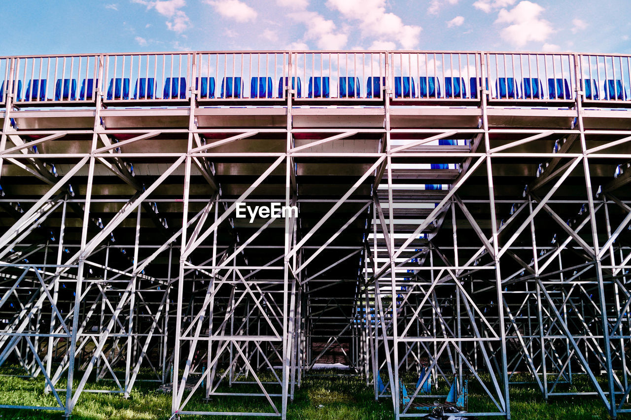 Metallic Built Structure On Field Against Sky