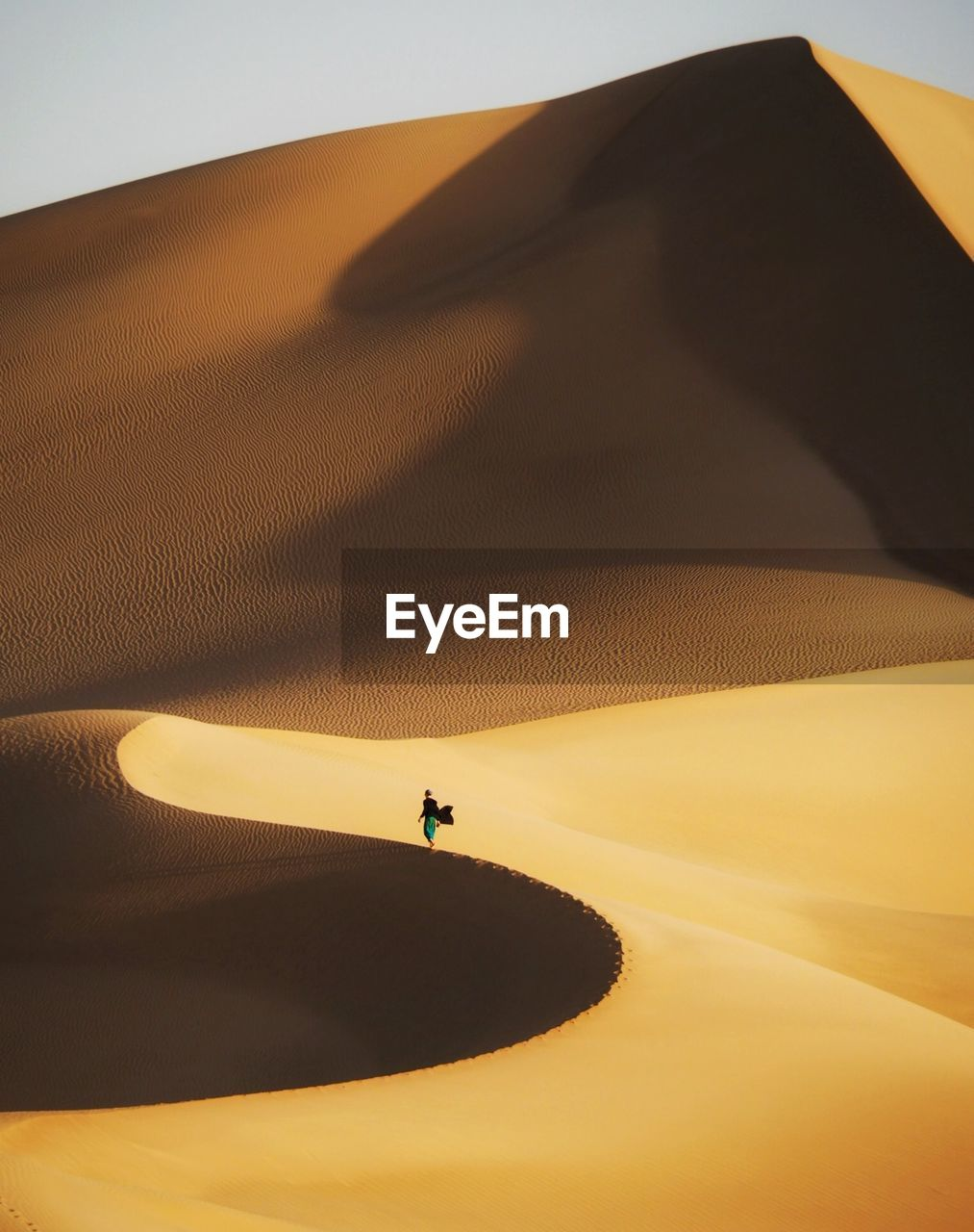 Distant View Of Woman Standing At Desert