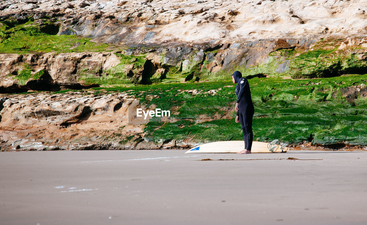 rock - object, rear view, real people, one person, day, full length, men, nature, outdoors, people