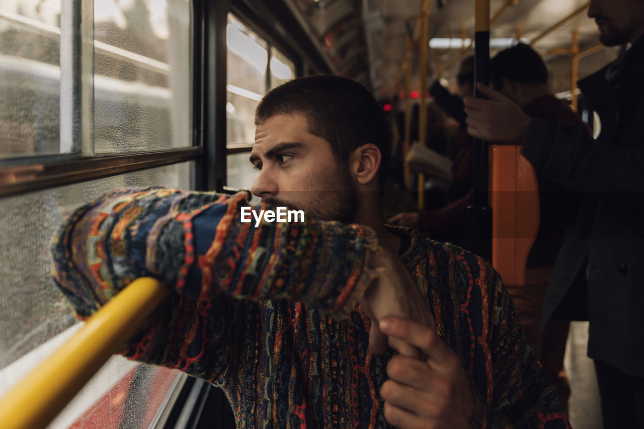 Man looking though window in bus