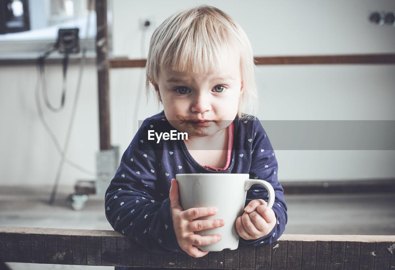 Portrait Of Girl Drinking Hot Chocolate From Mug