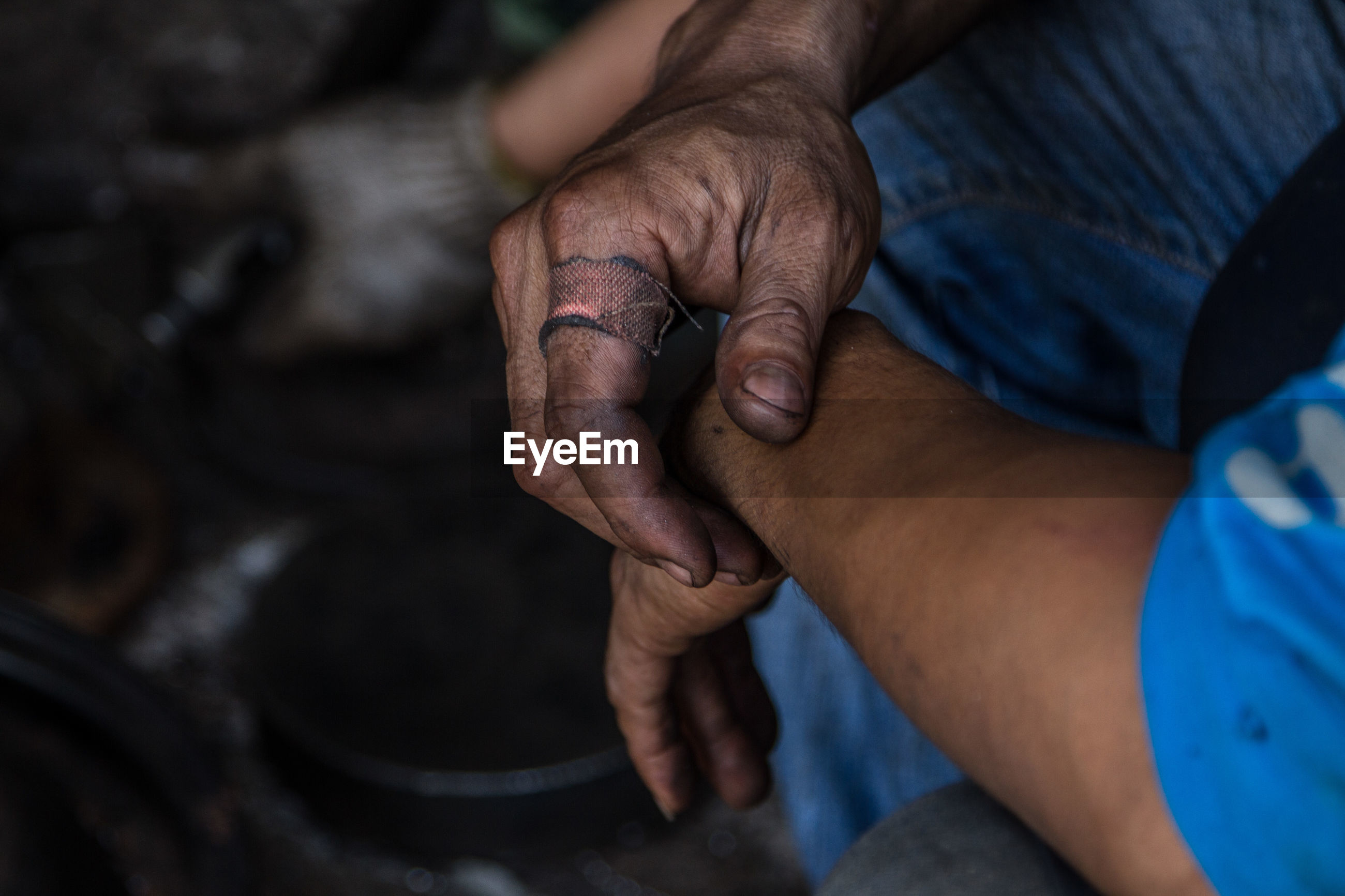 Cropped hands of worker at workshop