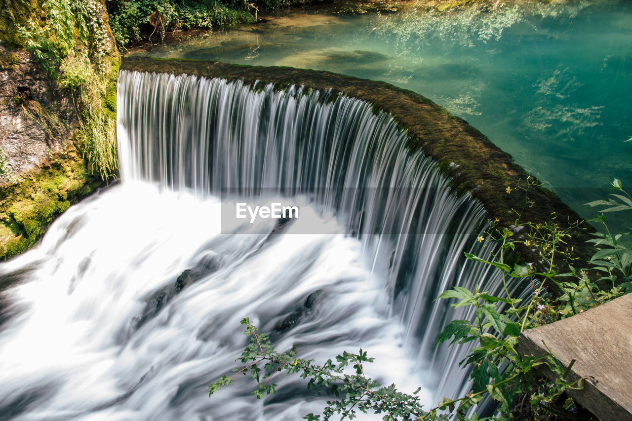 water, motion, flowing water, beauty in nature, long exposure, scenics - nature, nature, waterfall, blurred motion, day, no people, flowing, plant, tree, environment, hydroelectric power, power in nature, outdoors, sea, running water