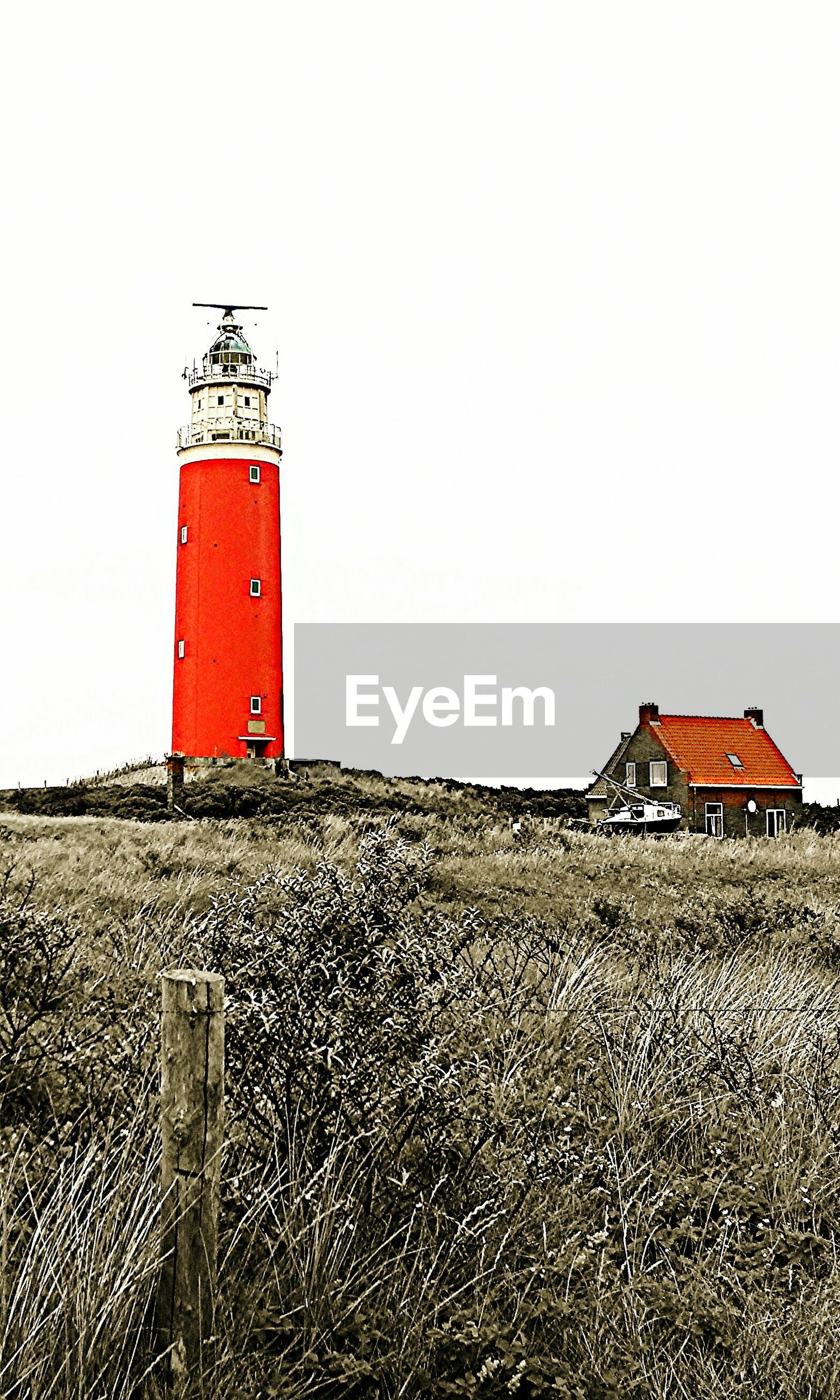 clear sky, copy space, built structure, building exterior, architecture, red, safety, protection, lighthouse, guidance, security, sand, house, day, direction, outdoors, landscape, no people, beach, field