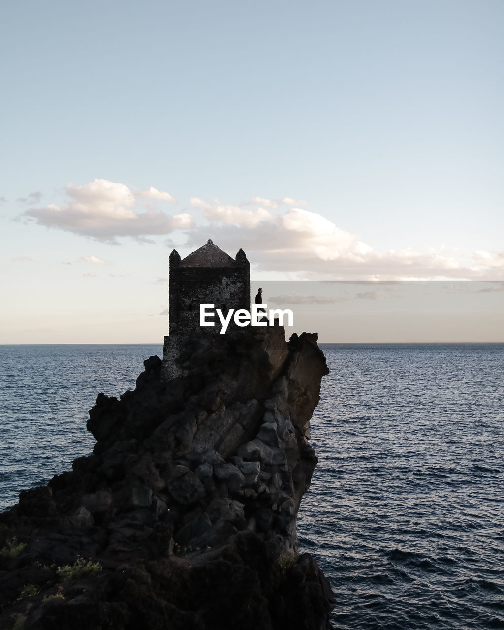 sea, water, sky, architecture, scenics - nature, built structure, horizon, horizon over water, rock, beauty in nature, nature, no people, building exterior, cloud - sky, building, rock - object, solid, history, tranquility, outdoors