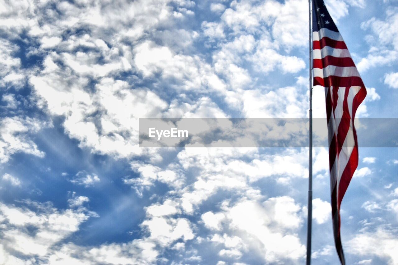 patriotism, flag, low angle view, sky, cloud - sky, flag pole, stars and stripes, day, striped, no people, outdoors, nature, beauty in nature