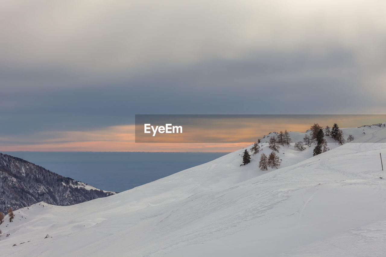 winter, cold temperature, snow, sky, beauty in nature, scenics - nature, tranquil scene, cloud - sky, tranquility, non-urban scene, environment, nature, covering, no people, mountain, white color, sunset, landscape, idyllic, outdoors, snowcapped mountain, mountain peak, range