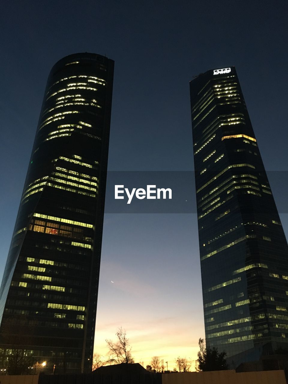 building exterior, sky, built structure, architecture, low angle view, city, tower, office building exterior, tall - high, building, illuminated, skyscraper, nature, no people, modern, night, outdoors, office, sunset, travel destinations, financial district
