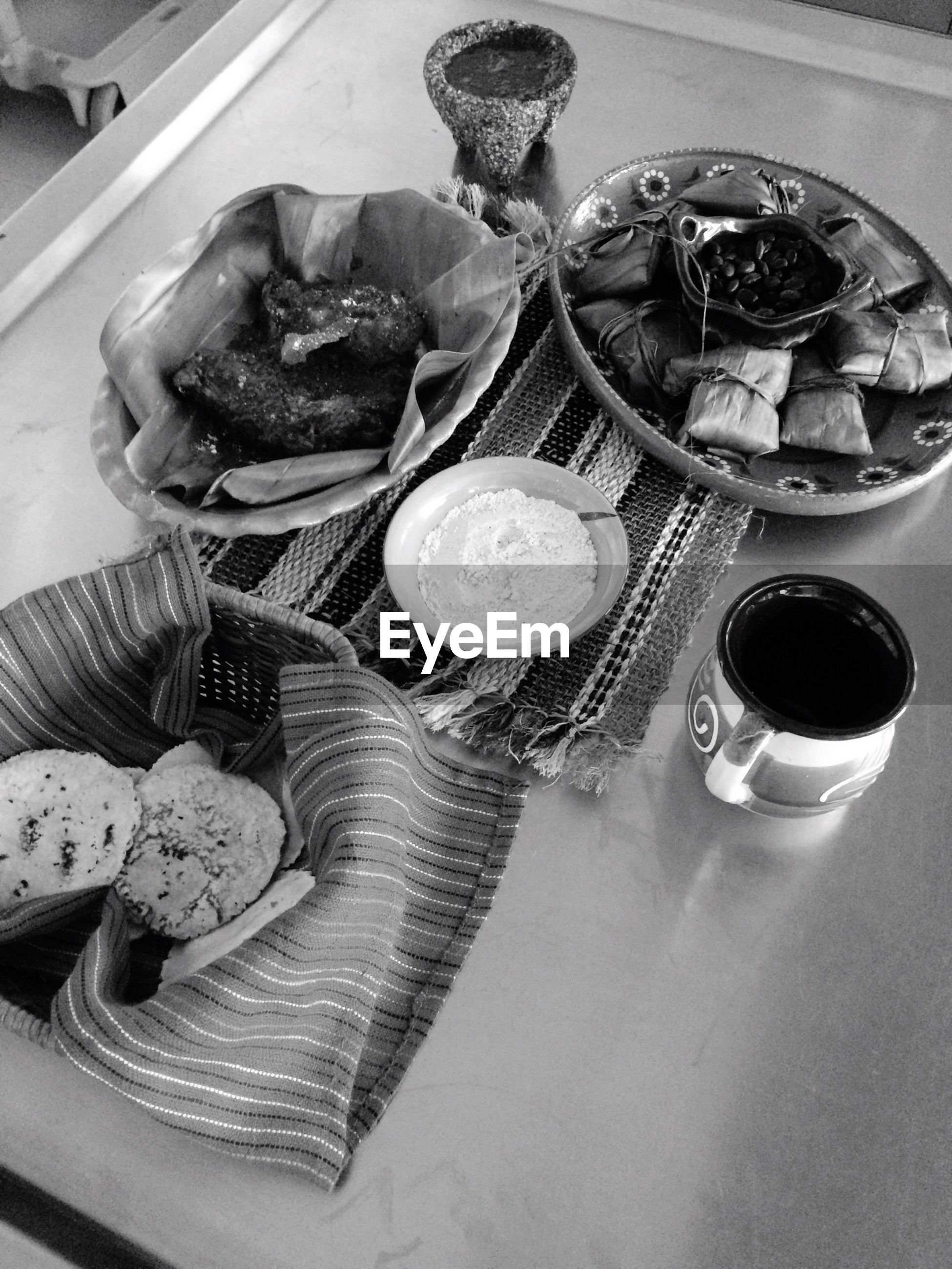 indoors, food and drink, table, still life, food, high angle view, freshness, spoon, plate, fork, drink, coffee cup, close-up, cup, healthy eating, sweet food, refreshment, ready-to-eat, coffee - drink, directly above